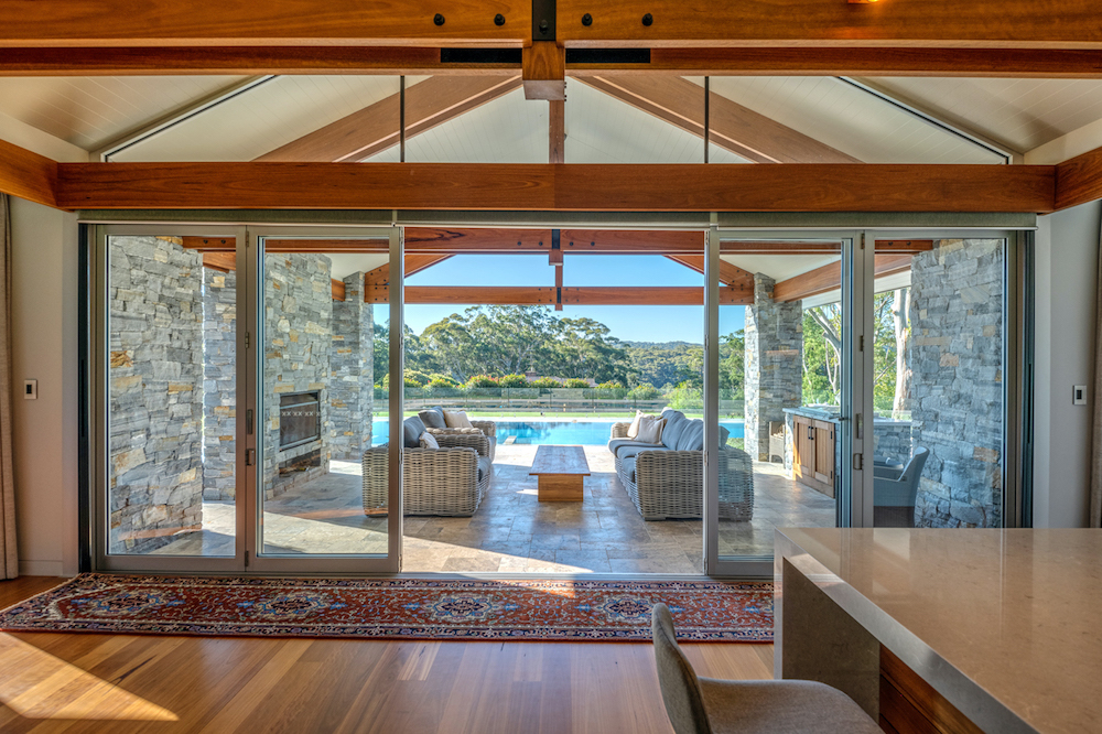 Kitchen Space Opens Up To Outdoor Setting With Pool & Acreage Views