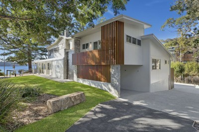Pearls On The Beach Building Features Timber & Stone Accents